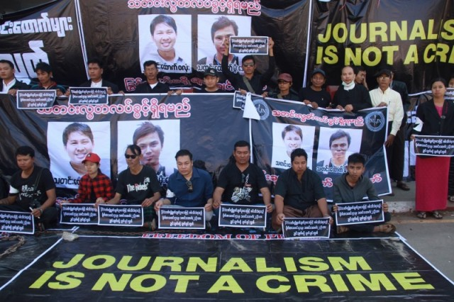 Journalists stage a protest to demand the release of Reuters journalists Wa Lone and Kyaw Soe Oo (pictured in posters behind) in Pyaye on December 27, 2017 (AFP)