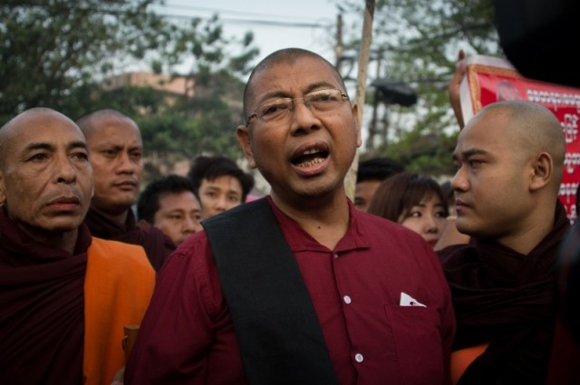 This photo taken on March 9, 2018 shows ultra-nationalist monk Pamaukkha (C) talking to the media after being released from Insein prison in Yangon.