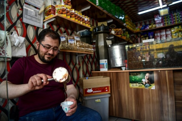 A Syrian coffee seller makes a coffee, in Gaziantep, in the south-west province of Turkey on May 1, 2018.